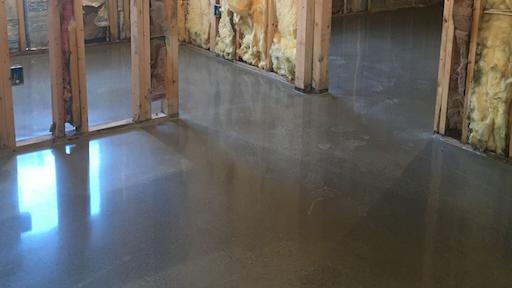Polishable Overlays Can Make Worn Concrete Floors Shimmer Like