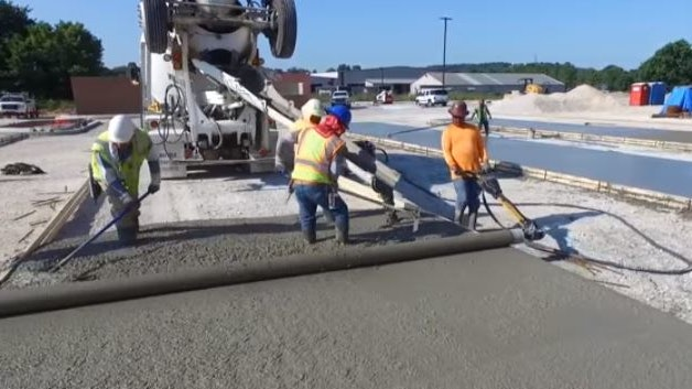 Video Curb Roller Hydra Screed Doing Flatwork For Construction Pros