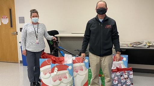 Erick Finley, owner of Finley Asphalt & Concrete donates presents to Prince William County Department of Social Services. These gifts benefit children who are in their foster care program.